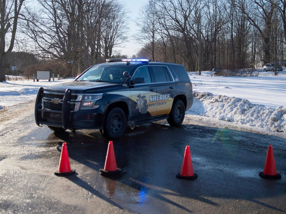 PHOTO: Kent County Sheriff personnel investigate the scene of a fatal shooting near the corner of 19 Mile NE and Division Avenue NE at a property on Monday, Feb. 18, 2019, near Cedar Springs, Mich.