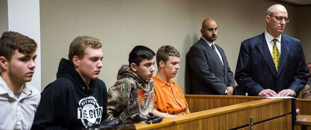 PHOTO: From left,Trevor Gray, 15, Alexzander Miller, 15, Mikadyn Payne, 16, and Kyle Anger, 17, all of Clio, Mich., appear for their arraignment in front of Judge William Crawford, Oct. 24, 2017, in Genesee County District Court in downtown Flint, Mich.