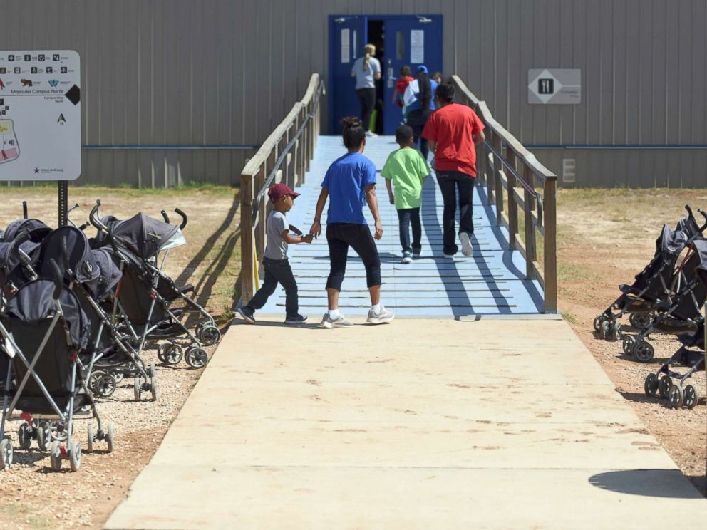 PHOTO: Immigrants walk into a building at South Texas Family Residential Center in Dilley, Texas, Aug. 9, 2018.