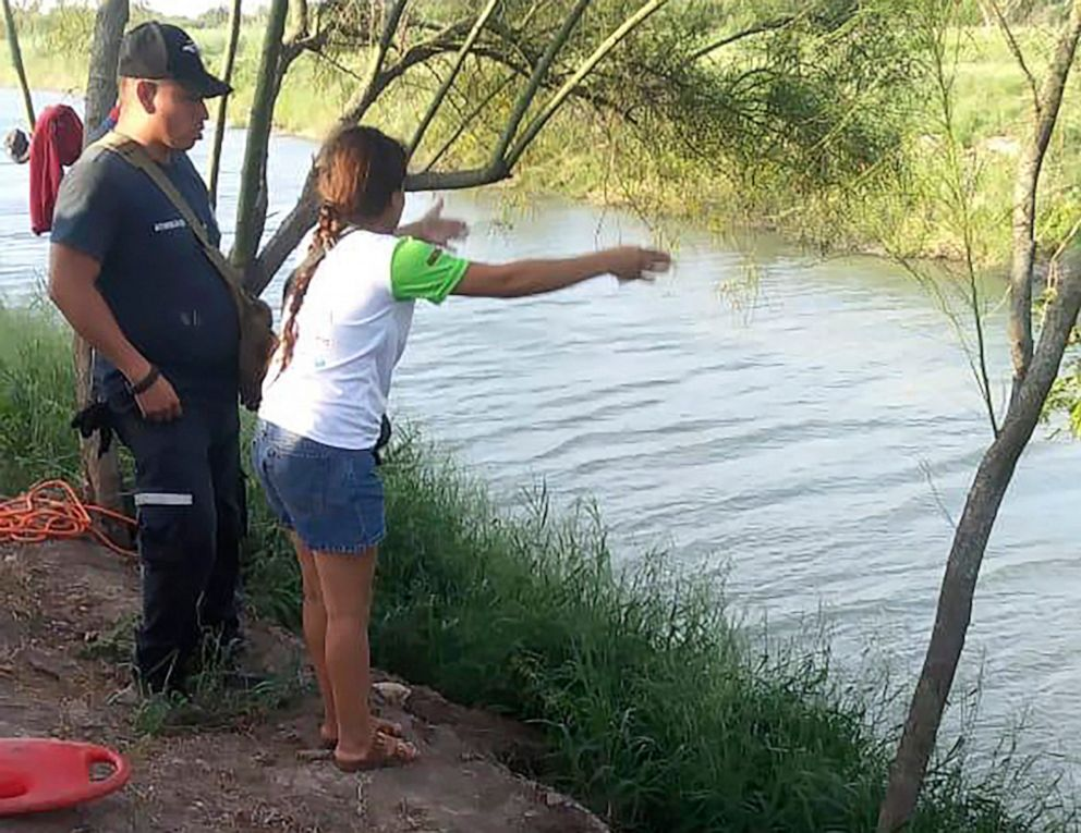 PHOTO: Tania Vanessa Avalos of El Salvador speaks with Mexican authorities, June 23, 2019, after her husband and nearly two-year-old daughter were swept away by the current in Matamoros, Mexico, while trying to cross the Rio Grande to Brownsville, Texas.