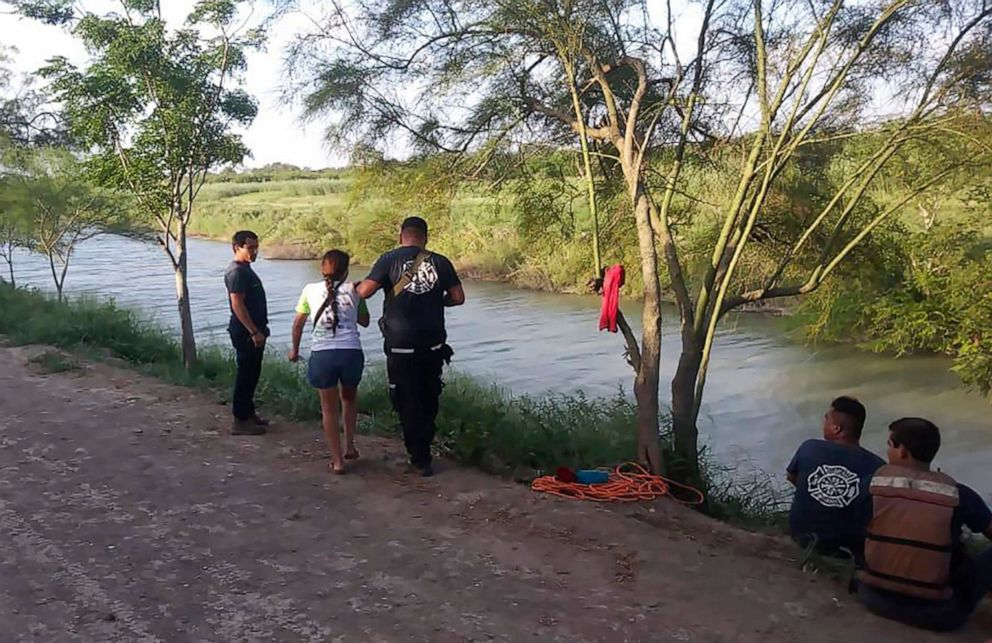 PHOTO: Tania Vanessa Avalos of El Salvador, center left, is assisted by Mexican authorities after her husband and nearly two-year-old daughter drowned trying to cross the Rio Grande to Brownsville, Texas, in Matamoros, Mexico, June 23, 2019.