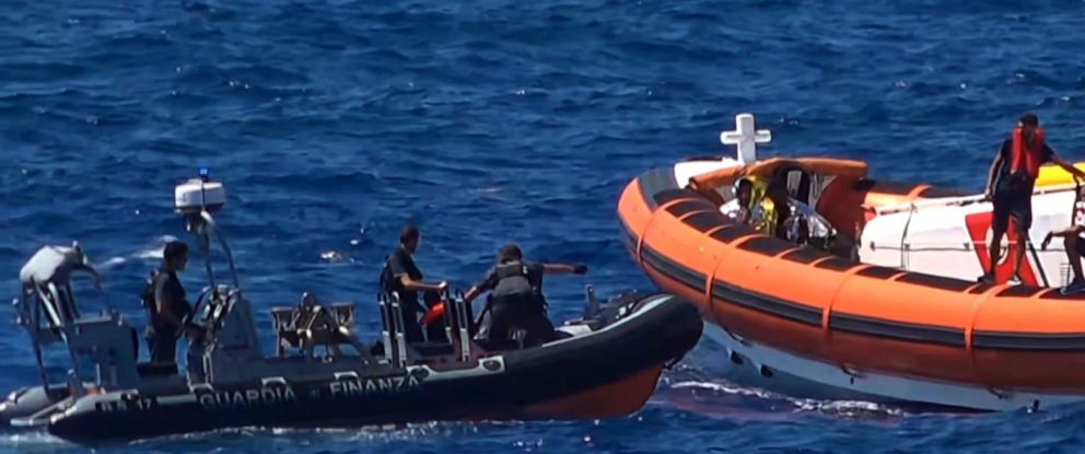 PHOTO: Migrants are rescued by NGO Proactiva Open Arms charity after throwing themselves in the water to try and swim to the nearby Italian island of Lampedusa, Aug. 20, 2019.