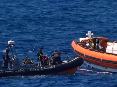 Migrants jump overboard from rescue ship after being denied port in Italy