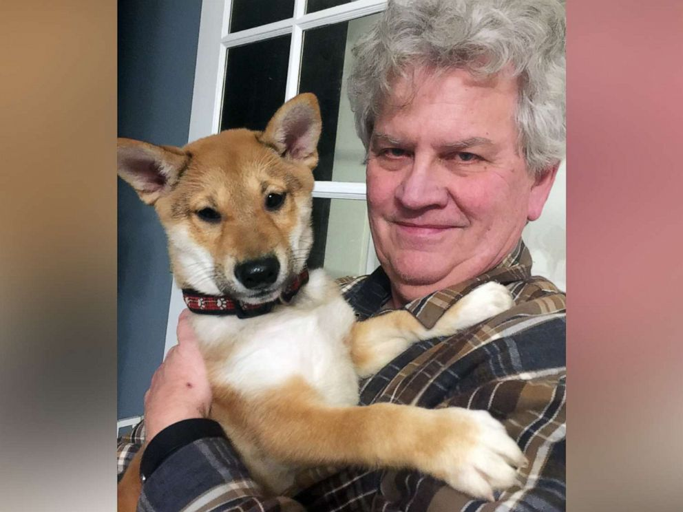 PHOTO: Mike Krueger holds his puppy Taka in a 2019 photo. Krueger and his wife Olga, of Morrison, Ill., only had Taka for a few days before the dog died from parvovirus.