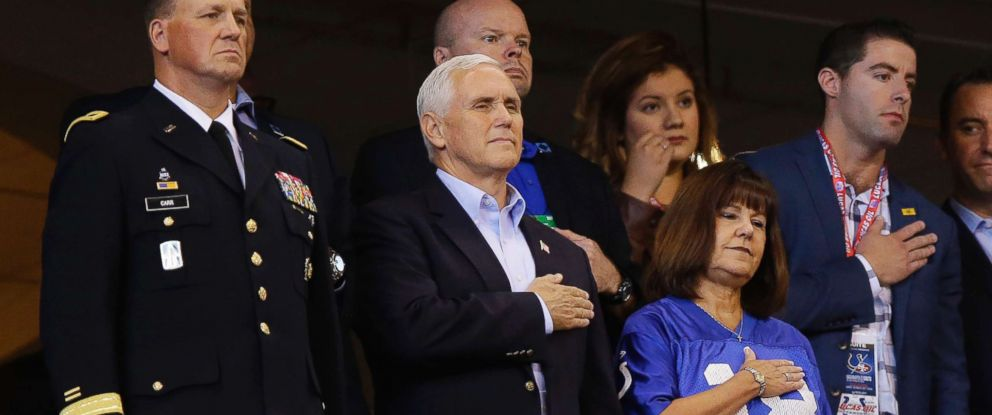 PHOTO: Vice President Mike Pence, front center, stands during the playing of the national anthem before an NFL football game between the Indianapolis Colts and the San Francisco 49ers, Oct. 8, 2017, in Indianapolis.