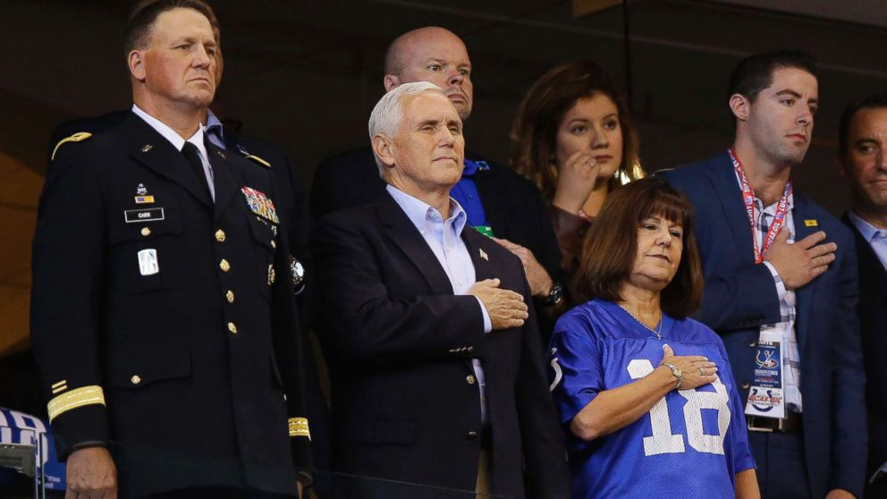 Vice President Mike Pence, front center, stands during the playing of the national anthem before an NFL football game between the Indianapolis Colts and the San Francisco 49ers, Oct. 8, 2017, in Indianapolis.