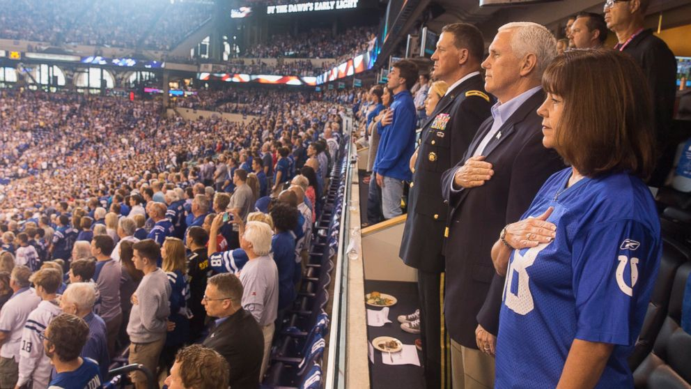 Vice President Mike Pence (2nd R) and his wife Karen Pence (R) stand during the national anthem before the San Francisco 49ers at Indianapolis Colts NFL game, at Lucas Oil Stadium in Indianapolis, Oct. 8, 2017.