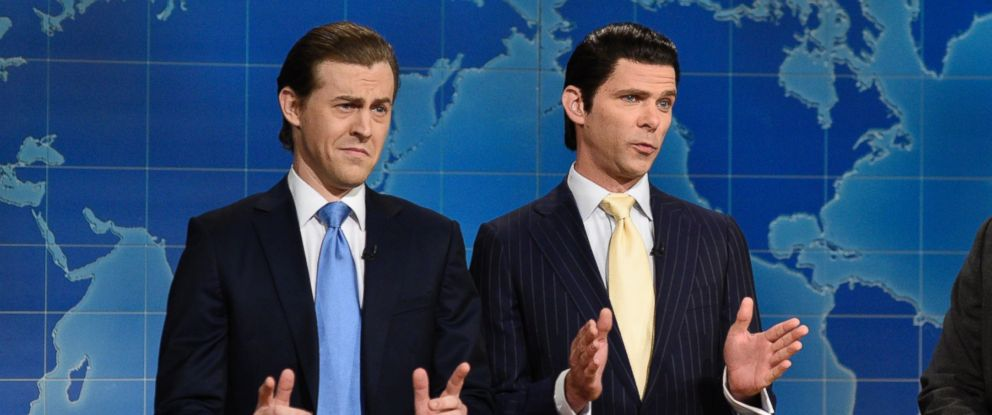 """PHOTO: This August 10, 2017, photo provided by NBC shows Alex Moffat as Eric Trump, left, Mikey Day as Donald Trump Jr., center, and Colin Jost on set during the debut episode of """"Weekend Update: Summer Edition,"""" in New York."""