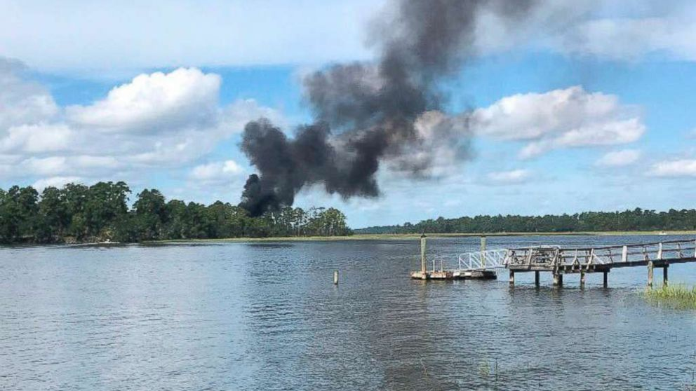 Smoke bellows from a military jet that crashed, Friday, Sept. 28, 2018 in Beaufort, S.C.