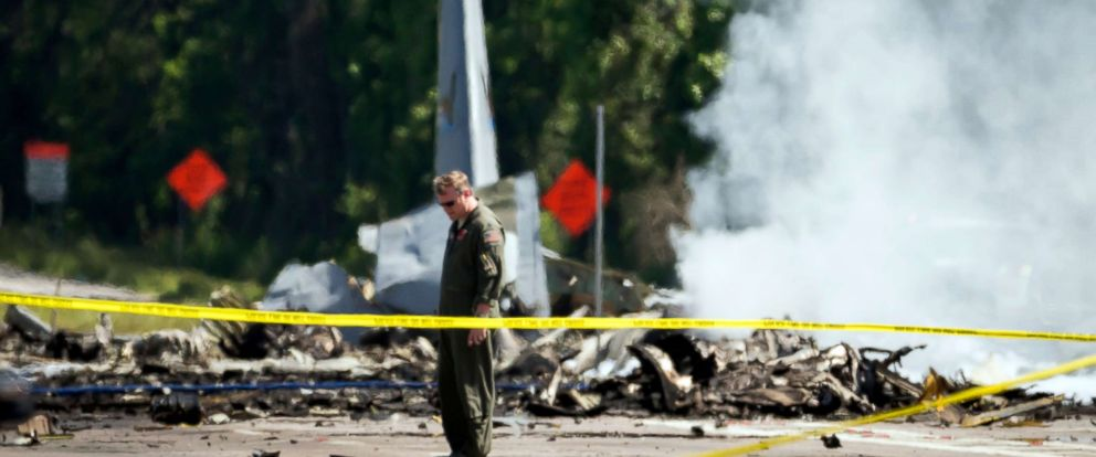 PHOTO: The tail of a military C-130 plane sticks up from the road as emergency crews work the site of the crash in Port Wentworth, Ga., May 2, 2018.