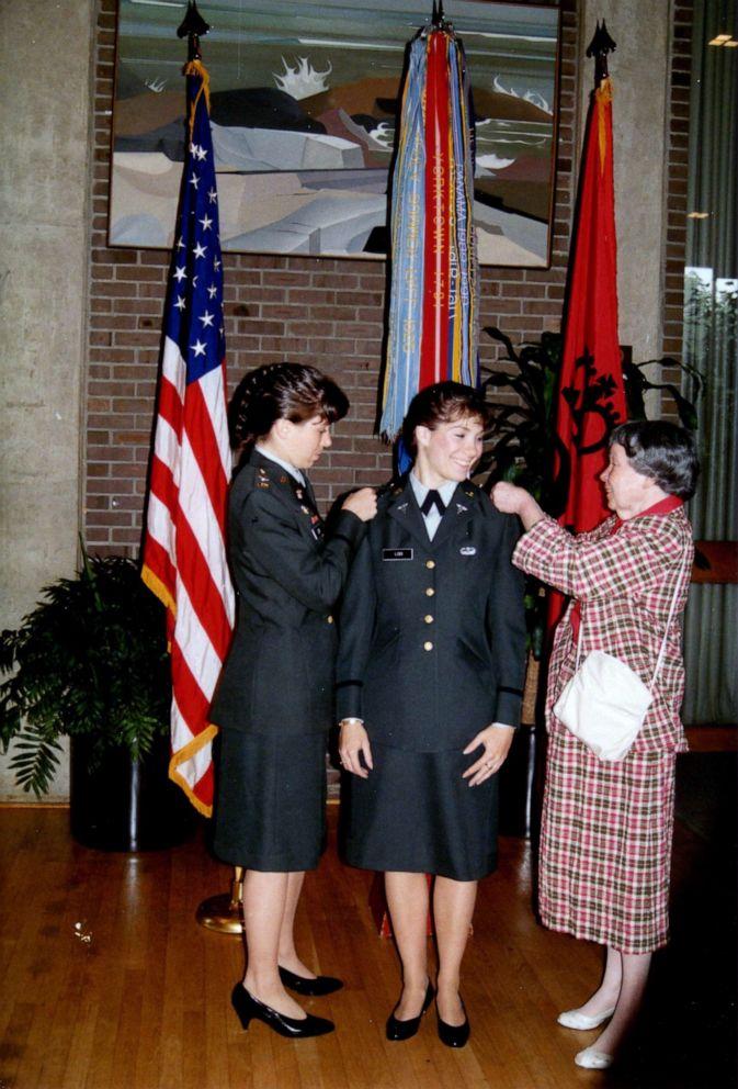PHOTO: Maj. Gen. Maria Barrett and her mother, Clara Lodi, pin 2d Lt. rank on Paula Lodi during a commissioning ceremony at Rutgers University, 1990.