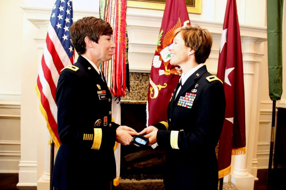 PHOTO: Maj. Gen. Maria Barrett presenting Brig. Gen. Paula Lodi a beret with one-star rank insignia as a tribute to the history of women serving in the Army and the historic moment of sisters serving together as General Officers.