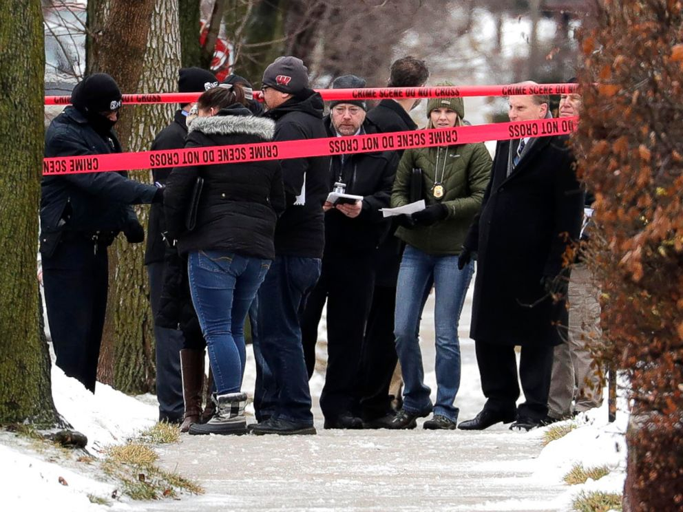 PHOTO: Milwaukee Police inspectors gather in front of a home near 12th and Dakota that was taped off as a crime scene, Feb. 6, 2019, after a Milwaukee Police officer was shot Wednesday morning on the citys south side.