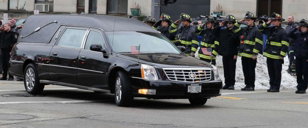 PHOTO: Milwaukee firefighters salute the hearse transporting the body of a Milwaukee police officer who was killed on the morning of Feb. 6, 2019.