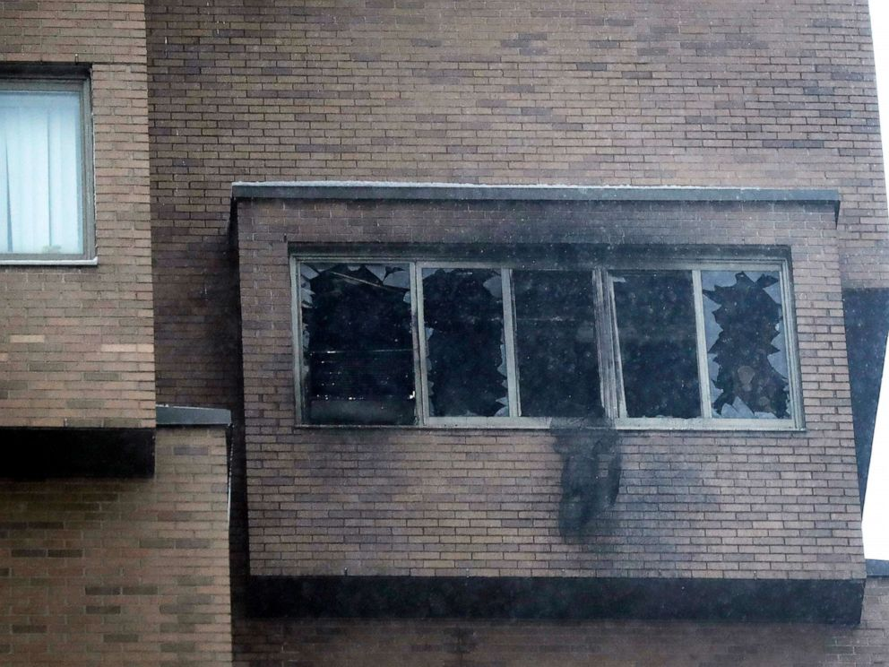 PHOTO: Broken windows and damage remain after a fire at the high-rise apartment building Nov. 27, 2019, in Minneapolis.