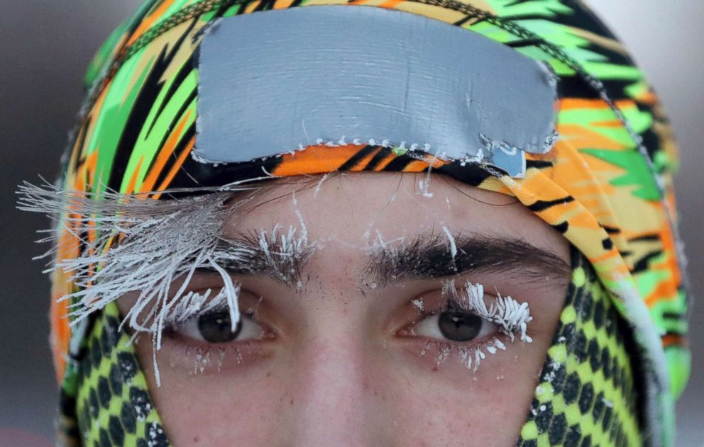 Frost covers part of the face of University of Minnesota student Daniel Dylla during a morning jog along Mississippi River Parkway, Jan. 29, 2019, in Minneapolis.