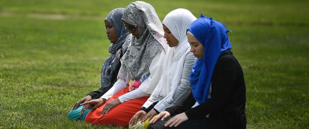 PHOTO: A group of women take part in afternoon prayers led by Dar Al Farooq Islamic Center Executive Director Mohamed Omar outside the police tape surrounding the center, Aug. 5, 2017 in Bloomington, Minn.