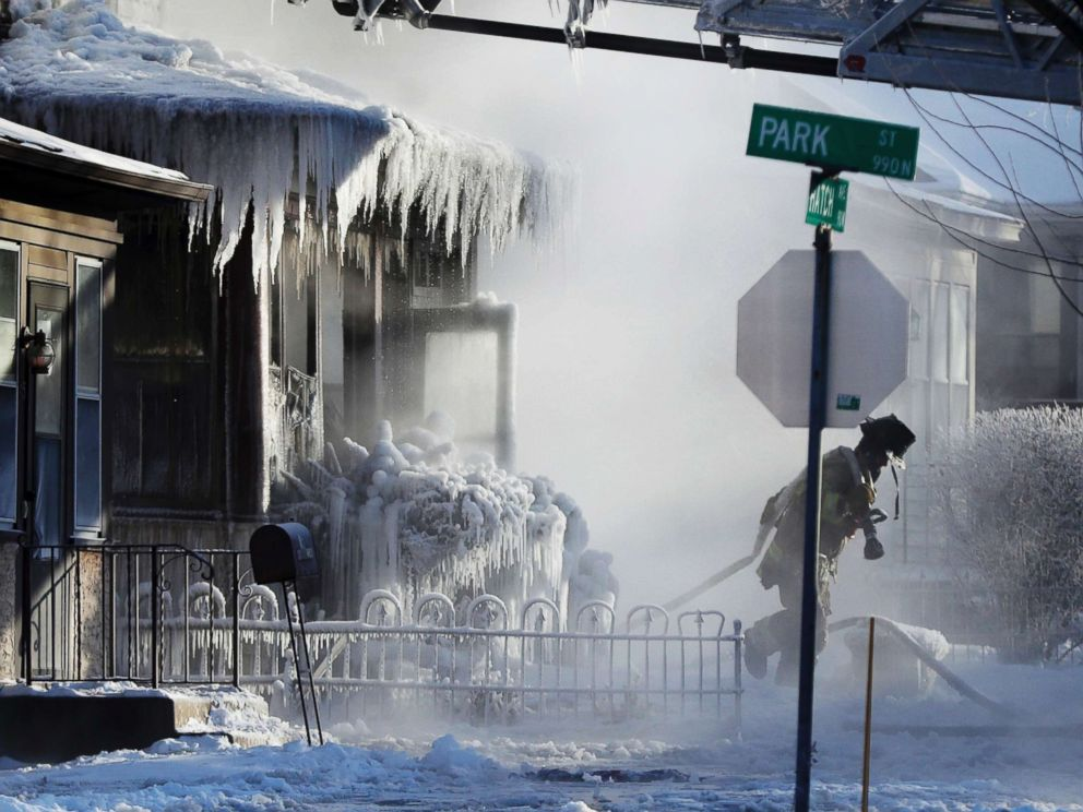 PHOTO: St. Paul firefighters at the scene of a house fire during a arctic deep freeze, Jan. 30, 2019, in St. Paul, Minn.