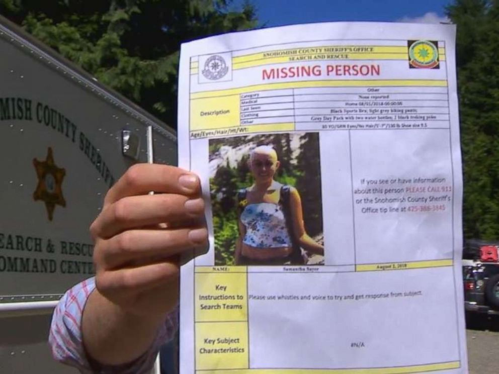 Snohomish County authorities hold a missing person poster for Sam Sayers, 28, who never returned from a hike on Vesper Peak in Washington on Wednesday, Aug. 1, 2018.  Desperate search continues for hiker missing 4 days on Washington mountain missing hiker komo mo 20180805 hpMain 4x3 992