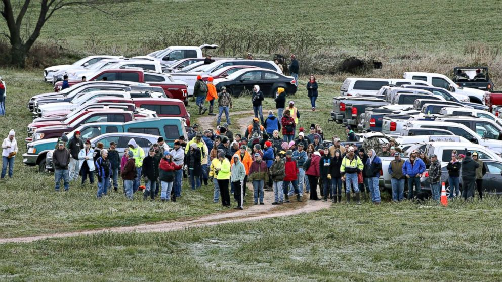 Hundreds of volunteers gather, Oct. 23, 2018, in Barron, Wis., to assist in the search for Jayme Closs, a missing teenage Wisconsin girl, whose parents were killed in the family's home. Closs has been missing since Oct. 15, when deputies responding to a 911 call found that someone had broken into the family's home in Barron and gunned down James and Denise Closs.