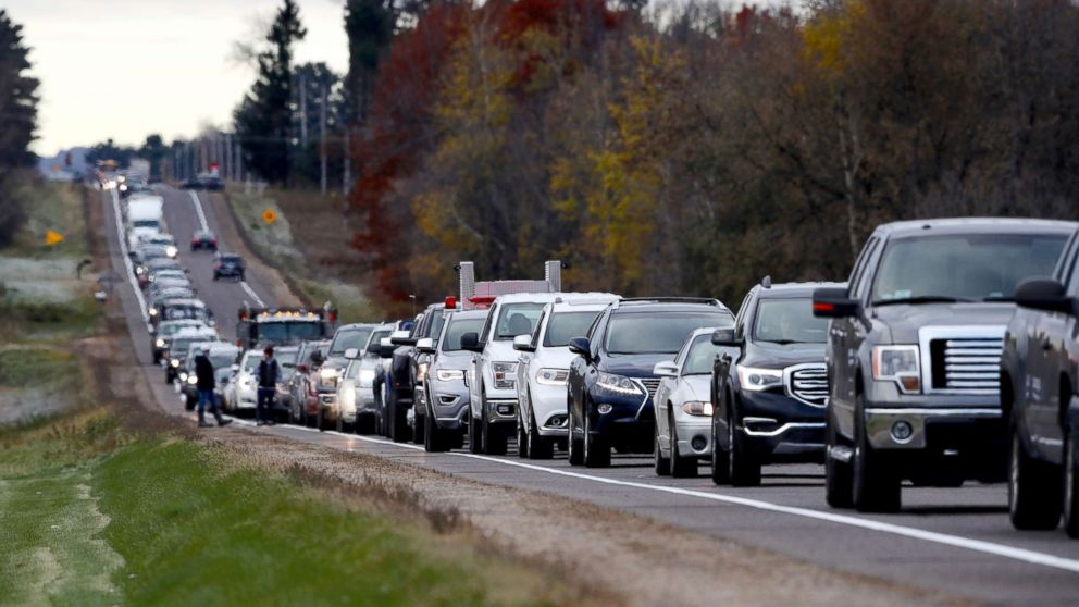 Volunteers lined up along Highway 25 just north of Barron, Wis., in the morning of Oct. 23, 2018 to help in the Jayme Closs search.