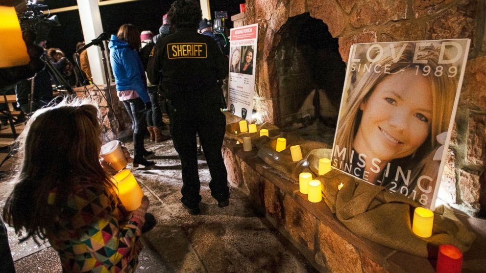 In this Dec. 13, 2018 file photo, community members hold a candlelight vigil for Kelsey Berreth under the gazebo of Memorial Park in Woodland Park, Colo. Authorities say they have arrested the fiance of the Colorado woman who was last seen on Thanksgiving.