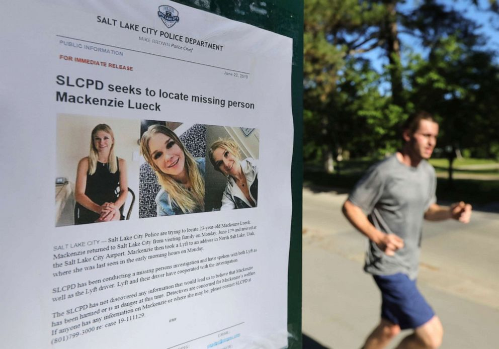 PHOTO: A jogger runs pass a poster of Mackenzie Lueck at Liberty Park in Salt Lake City, June 24, 2019.