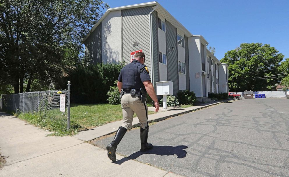 PHOTO: A police officer walks to a building where a man was taken into custody in connection with missing University of Utah student MacKenzie Lueck Friday, June 28, 2019, in Salt Lake City.