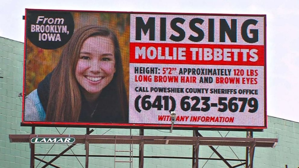 A missing person billboard for University of Iowa student Mollie Tibbetts.