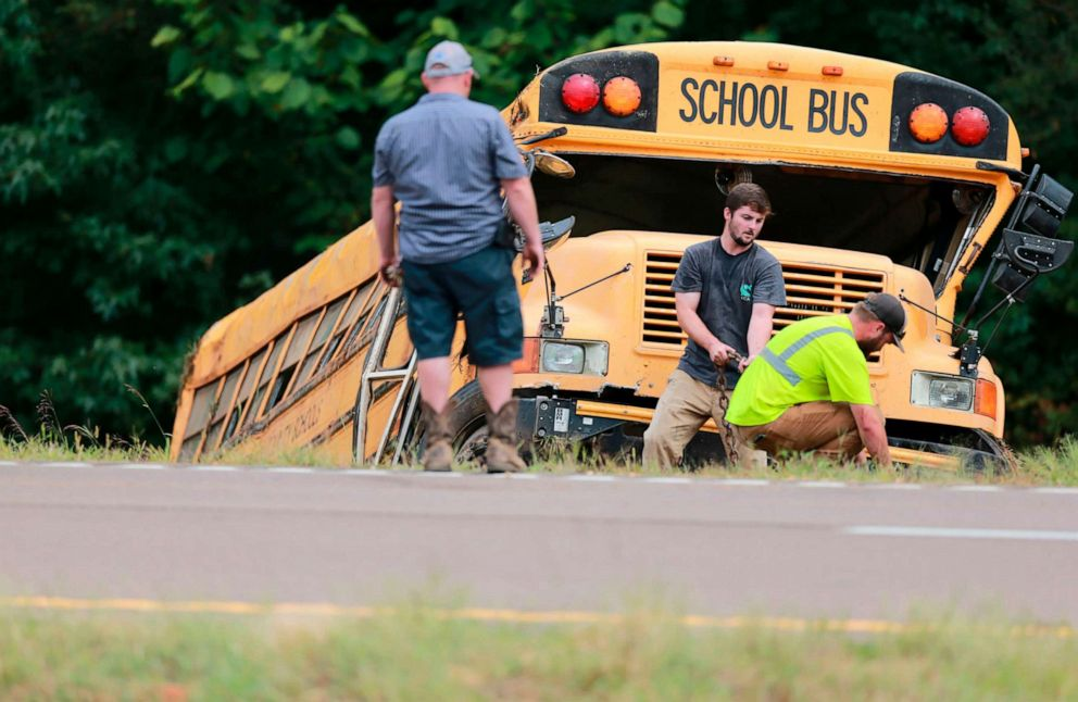 PHOTO: Wrecker crews work on a Benton County School bus that was involved in wreck along U.S. Highway 72 near Walnut, Miss., Sept. 10, 2019.