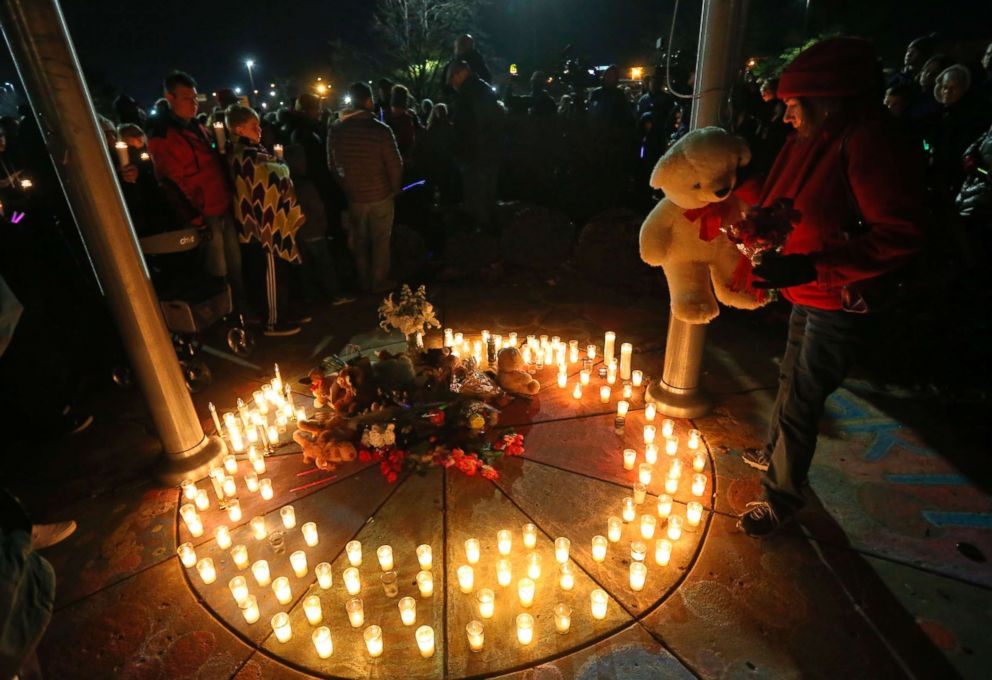 PHOTO: Barb Moran places a stuffed animal in the center of a memorial in honor of Kate Kasten and her children in St. Charles, Mo., Dec. 30, 2018.