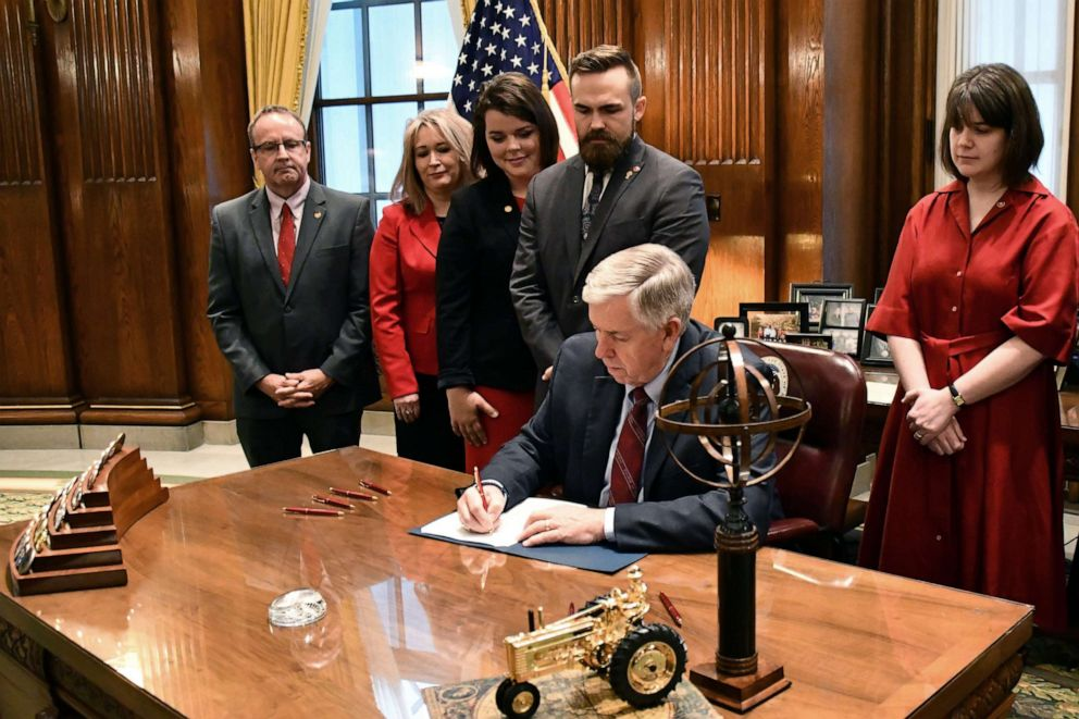 PHOTO: Missouri Governor Mike Parson signs a bill banning abortion after the eighth week of pregnancy at his office in Jefferson City, Mo., May 24, 2019.