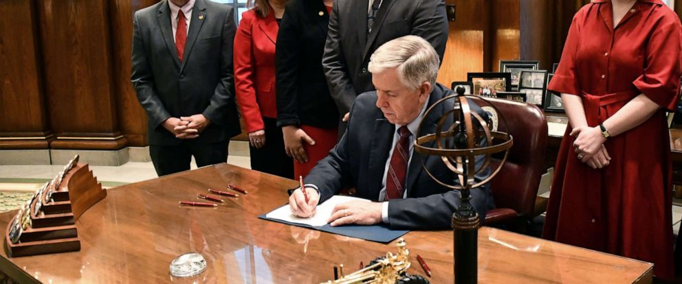PHOTO: Missouri Governor Mike Parson signs a bill banning abortion after the seventh week of pregnancy at his office in Jefferson City, Mo., May 24, 2019.