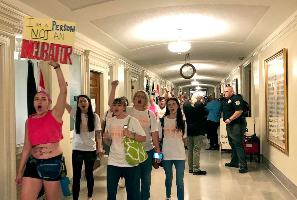 PHOTO: Protesters march through the halls of the Missouri Capitol outside the House chamber, May 17, 2019, in Jefferson City, Missouri, in opposition to legislation prohibiting abortions at eight weeks of pregnancy.