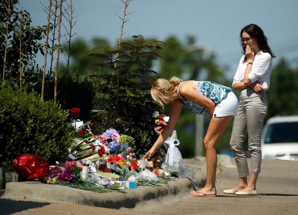 PHOTO: People look at a memorial in front of Ride the Ducks, July 21, 2018 in Branson, Mo.