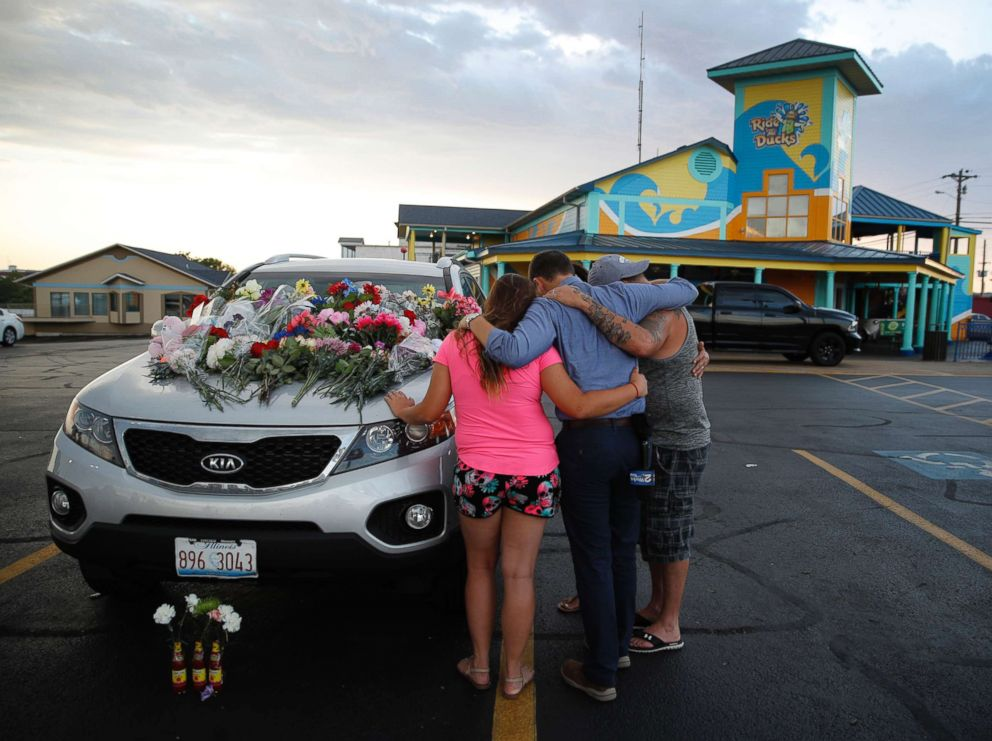 PHOTO: People pray by a car thought to belong to a victim of Thursdays boating accident before a candlelight vigil in the parking lot of Ride the Ducks, July 20, 2018, in Branson, Mo.