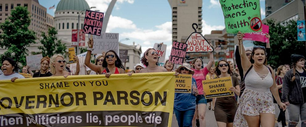 PHOTO: People chant and walk through downtown St. Louis during a rally and march to protest the closure of the last abortion clinic in Missouri on May 30, 2019, in St. Louis.