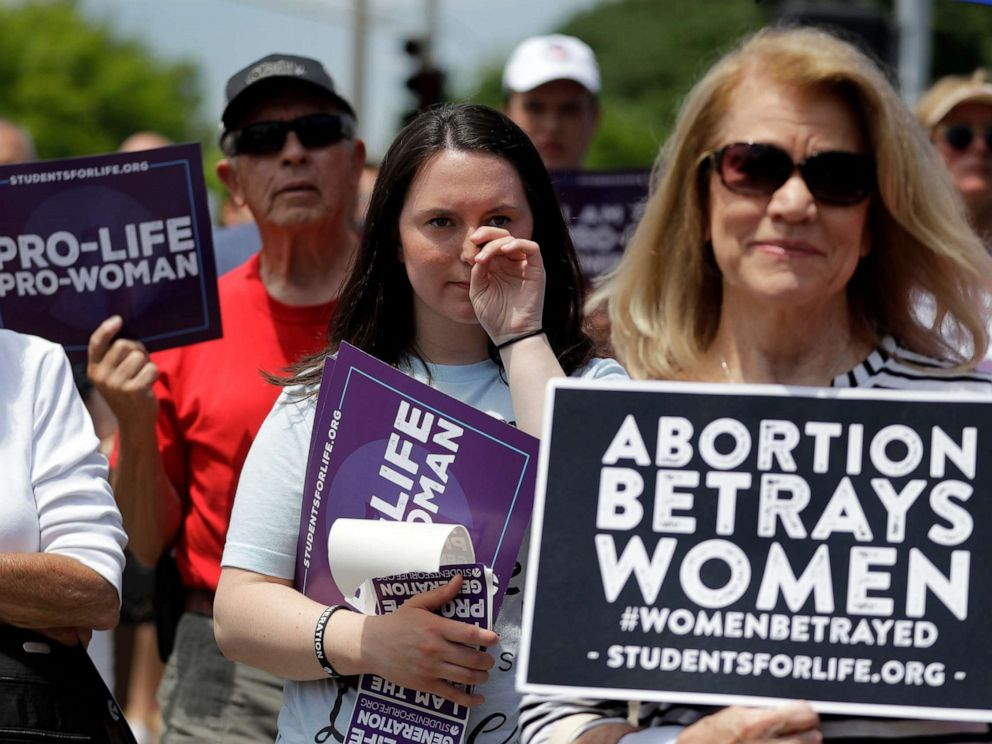 PHOTO: Anti-abortion supporters gather outside the Planned Parenthood clinic Tuesday, June 4, 2019, in St. Louis.