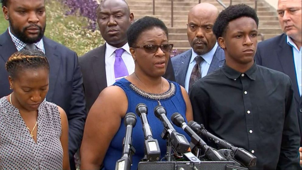 Allison Jean stands between her children, Allisa Charles-Findley and Brandt Jean, as she speaks at a press conference in Dallas on Monday, Sept. 10, 2018, of her son, Botham, who was allegedly shot to death by a Dallas police officer who mistook his apartment for her residence.