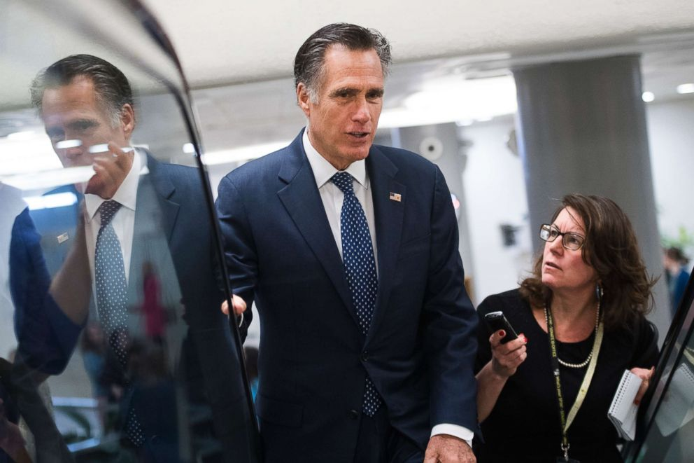 Sen. Mitt Romney talks with reporters before the Senate Policy luncheons in the Capitol, March 5, 2019.