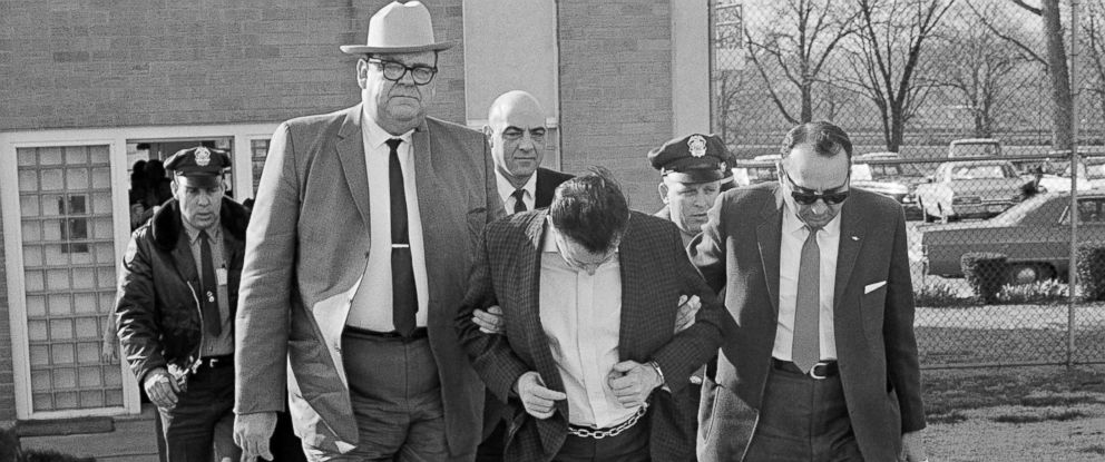 PHOTO: James Earl Ray lowers his head as State Safety commissioner Greg ORear, white hat, and Highway Patrol Maj. Mickey McGuire, dark glasses, lead him to prison in Nashville, Tenn., March 11, 1969.