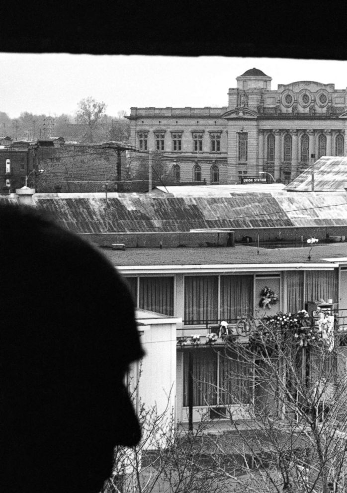 PHOTO: Charles Q. Stephens looks across the street to the Lorraine Motel, April 9, 1968, where flowers mark the spot that Martin Luther King Jr. was assassinated in Memphis, Tenn. This view, from the rooming house, is where the shoot took place.