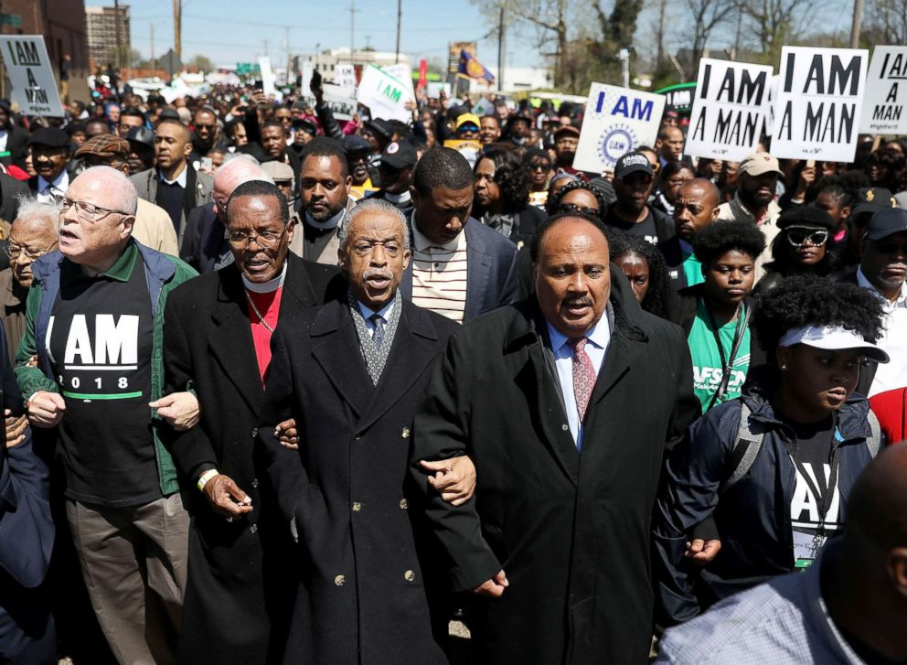 Rev. Al Sharpton (C), Bishop Charles Blake (2nd L) and Martin Luther King III (2nd R) lead a march on the anniversary of the assassination of Martin Luther King, Jr., April 4, 2018 in Memphis, Tenn.