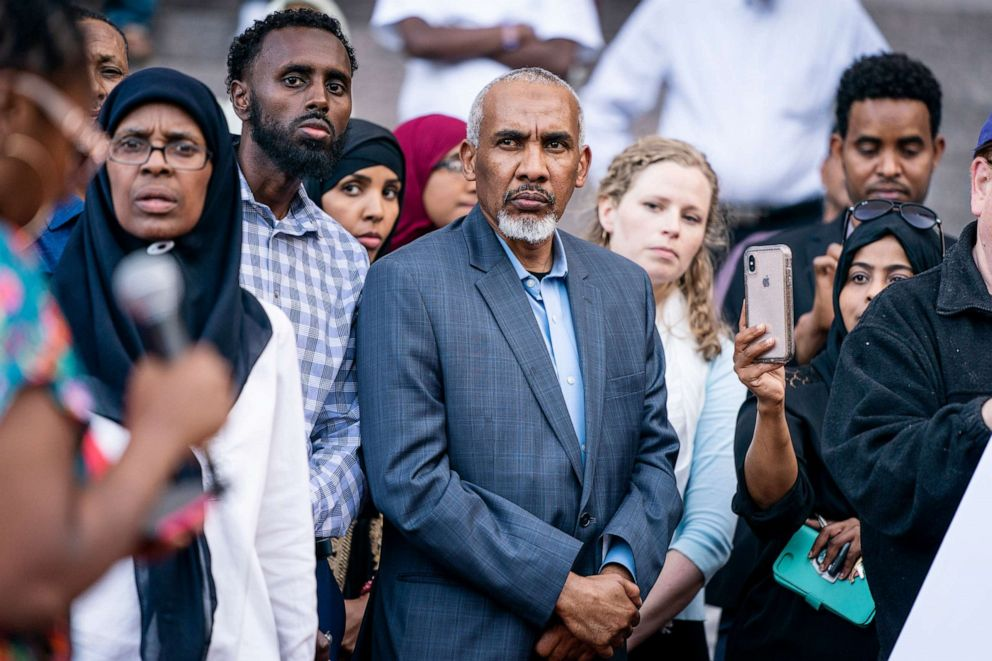 PHOTO: Mohamed Noors father, Mohamed Abass, center, attends a rally in support of the former Minneapolis police officer Thursday, June 6, 2019, in Minneapolis.