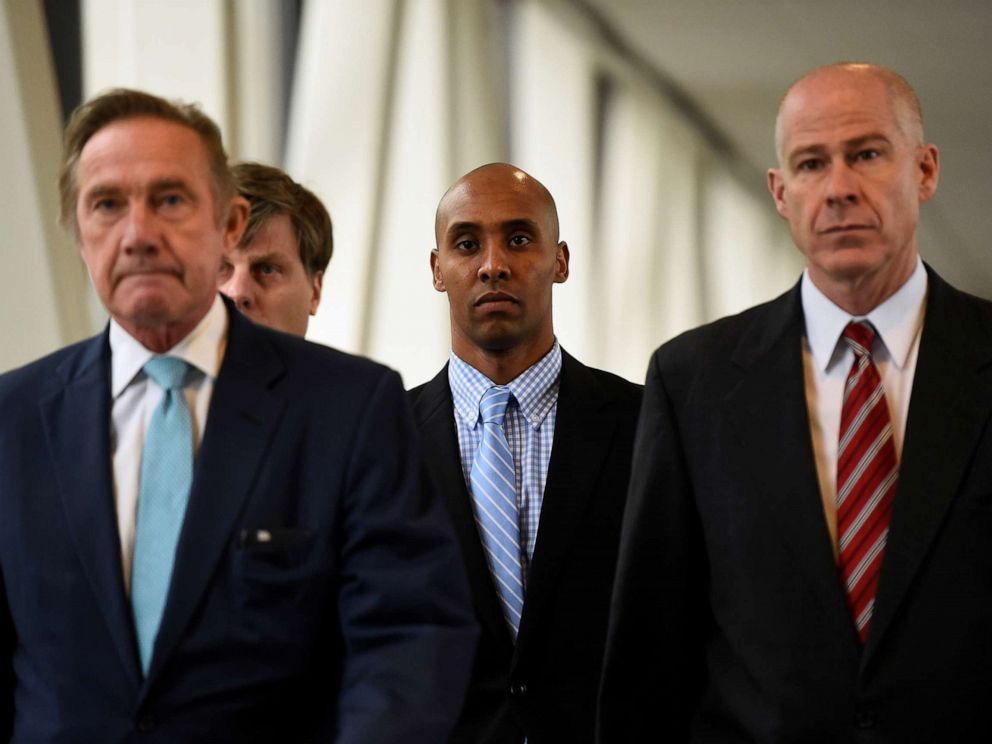 PHOTO: Mohamed Noor, center, former Minnesota policeman on trial for fatally shooting an Australian woman, walks into the courthouse in Minneapolis, Minn., April 30, 2019.