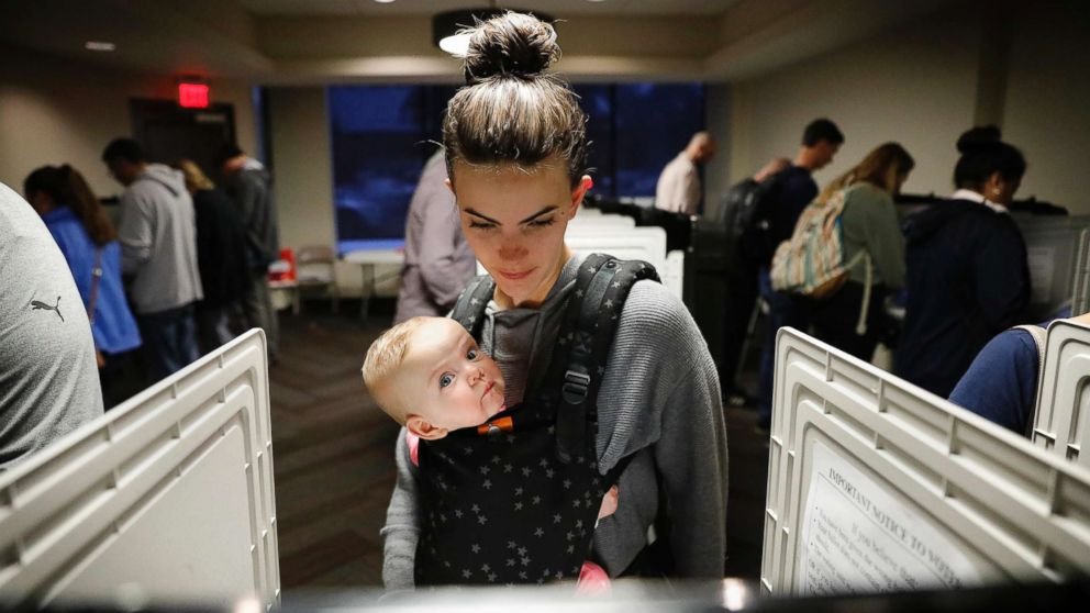 Kristen Leach votes with her daughter, Nora, on election day in Atlanta,  Nov. 6, 2018.