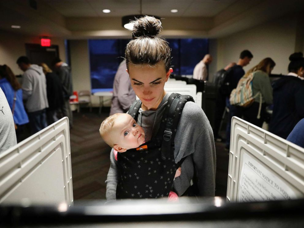 PHOTO: Kristen Leach votes with her daughter, Nora, on election day in Atlanta, Nov. 6, 2018.