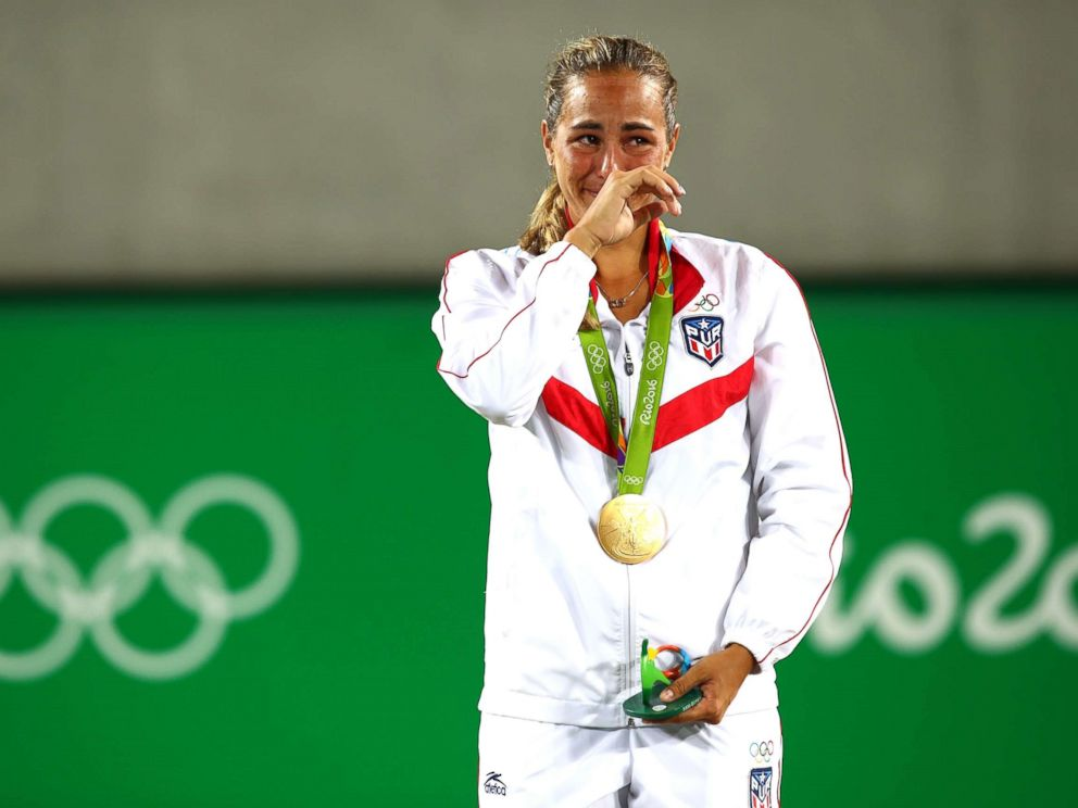 PHOTO: Gold medalist Monica Puig of Puerto Rico reacts during the medal ceremony for the Womens Singles Gold Medal Match on Day 8 of the Rio 2016 Olympic Games at the Olympic Tennis Centre, Aug. 13, 2016, in Rio de Janeiro, Brazil.