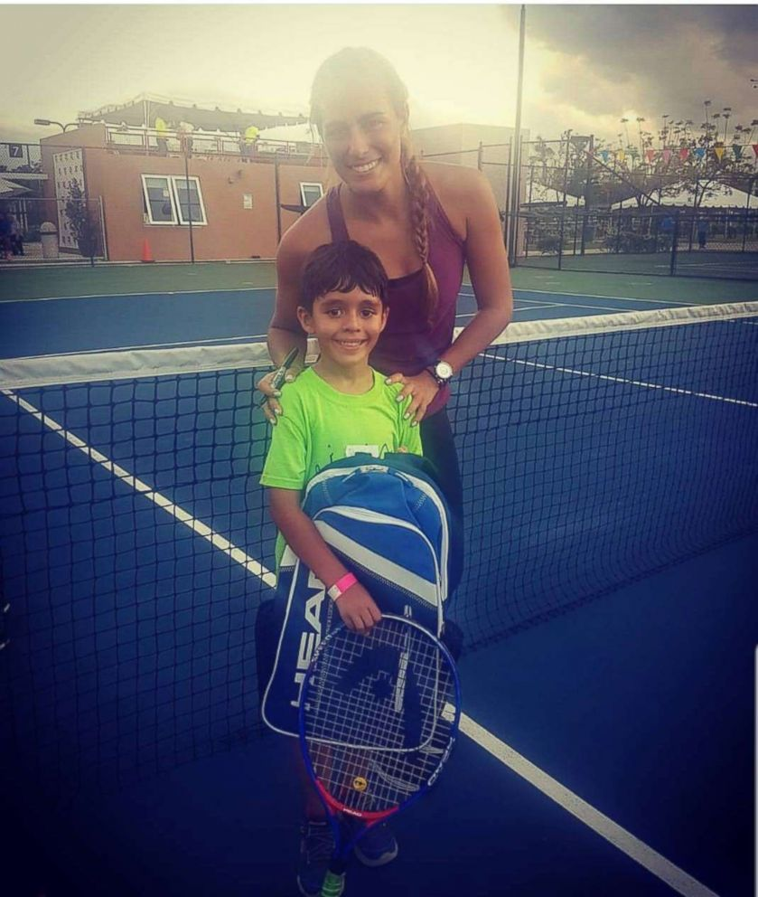 PHOTO: Tennis player Monica Puig with 7-year-old Jayden Omar Davila in Bayamon, Puerto Rico.