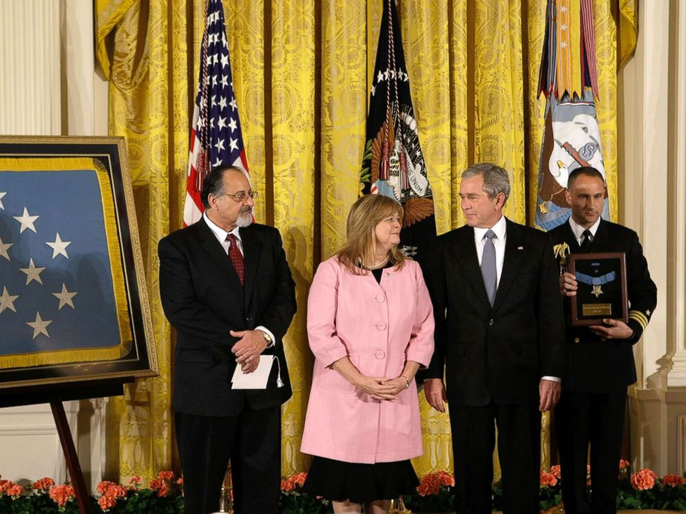PHOTO: President George W. Bush shares a moment with Sally Monsoor and George Monsoor during a ceremony to receive the Medal of Honor on behalf of their son Petty Officer 2nd Class Michael Monsoor, April 8, 2008, at the White House.